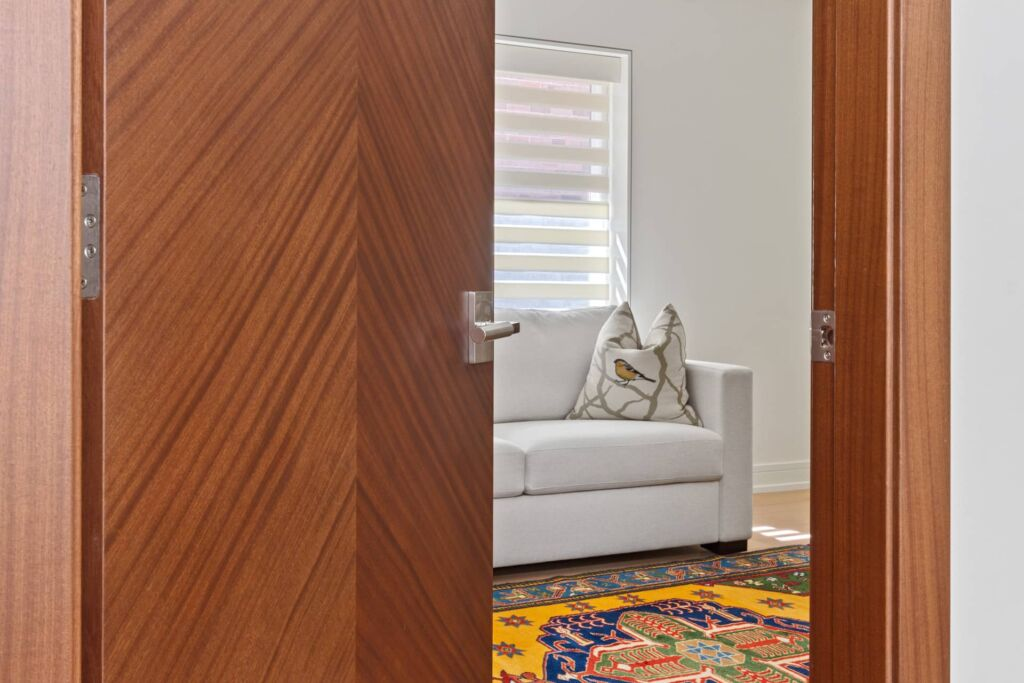 left-view-of-modern-interior-door-with-hardware-looking-onto-a-room